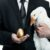 Businessman holding a goose that lays golden eggs