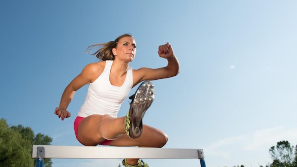 Professional female hurdler in action